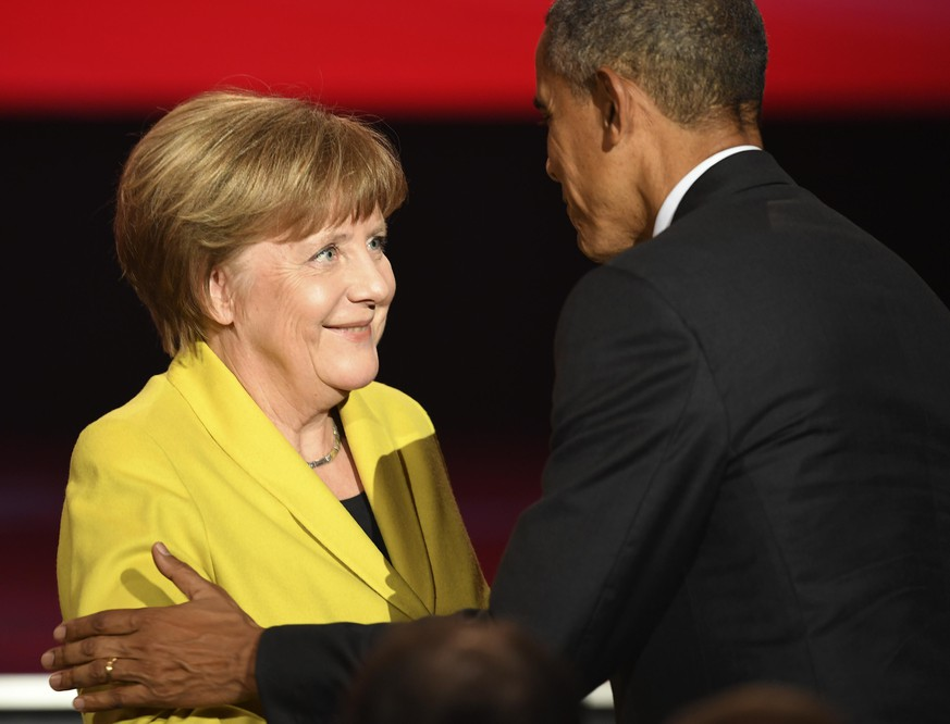 HANOVER, GERMANY - APRIL 24: U.S. Barack Obama greets German Chancellor Angela Merkel at the opening evening of the Hannover Messe trade fair on April 24, 2016 in Hanover, Germany. Obama met with German Chancellor Angela Merkel in Hanover earlier in the day and is scheduled to tour exhibition halls at the fair tomorrow. Hannover Messe is the world's largest industrial trade fair. (Photo by Alexander Koerner/Getty Images)