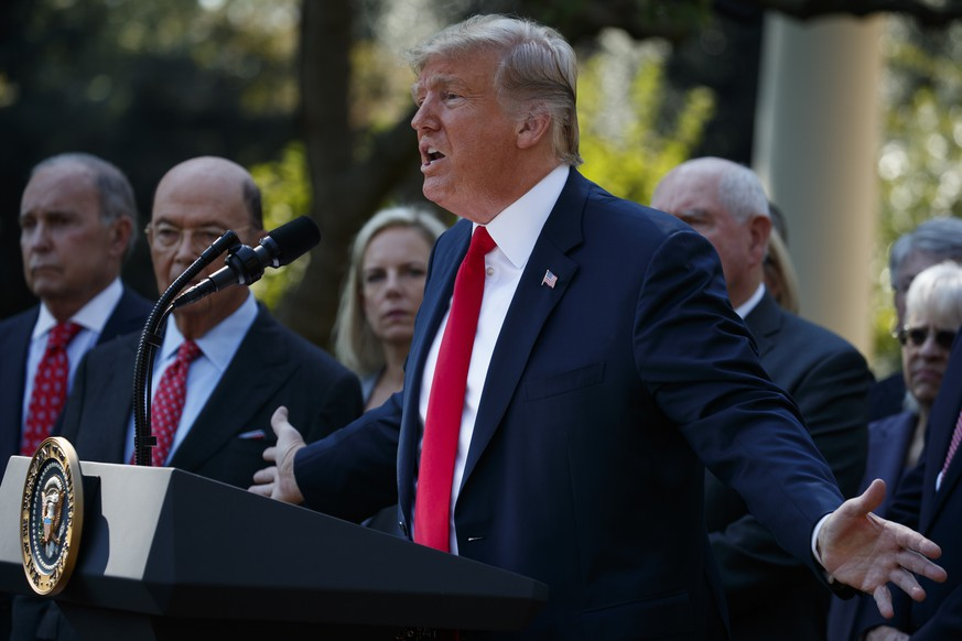 CORRECTS SPELLING OF LAST NAME TO KAVANAUGH INSTEAD OF CAVANAUGH - President Donald Trump speaks during a news conference on trade among the United States, Canada and Mexico, and the nomination of Brett Kavanaugh to the Supreme Court, in the Rose Garden of the White House, Monday, Oct. 1, 2018, in Washington. (AP Photo/Evan Vucci)