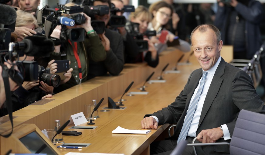 Friedrich Merz, right, member of the German Christian Democratic Party, arrives for a press conference in Berlin, Germany, Wednesday, Oct. 31, 2018. Friedrich Merz, 62, is one of three high-profile candidates vying to become leader of the center-right Christian Democratic Union. Merkel announced on Monday that she will give up the party's leadership after 18 years in December but plans to remain chancellor. (AP Photo/Michael Sohn)