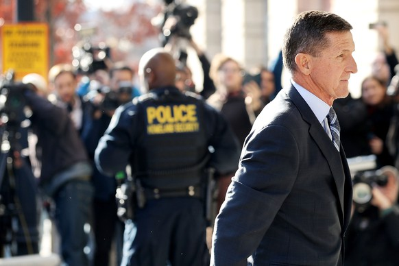 WASHINGTON, DC - DECEMBER 01:  Michael Flynn, former national security advisor to President Donald Trump, arrives for his plea hearing at the Prettyman Federal Courthouse December 1, 2017 in Washington, DC. Special Counsel Robert Mueller charged Flynn with one count of making a false statement to the FBI.  (Photo by Chip Somodevilla/Getty Images)