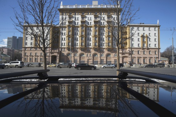 The U.S. Embassy is reflected in a car in Moscow, Russia, Thursday, March 29, 2018. Britain has accused Russia of a nerve agent attack on ex-spy Sergei Skripal and his daughter, the accusations Russia has fiercely denied, calling them unfounded. (AP Photo/Pavel Golovkin)