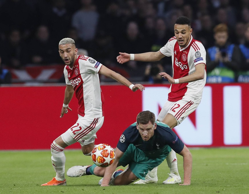 Jan Vertonghen of Tottenham brought down by Hakim Ziyech and Noussair Mazraoui of Ajax during the UEFA Champions League match at the Johan Cruyff Arena, Amsterdam. Picture date: 8th May 2019. Picture credit should read: David Klein/Sportimage PUBLICATIONxNOTxINxUK SPI-0075-0031