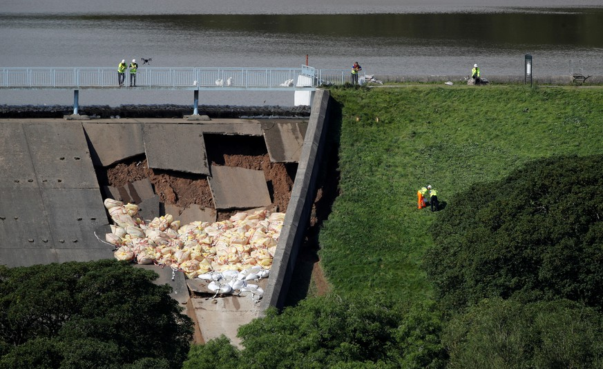 Workers use a drone to observe the damaged section of the dam in Whaley Bridge, Britain August 2, 2019. REUTERS/Phil Noble