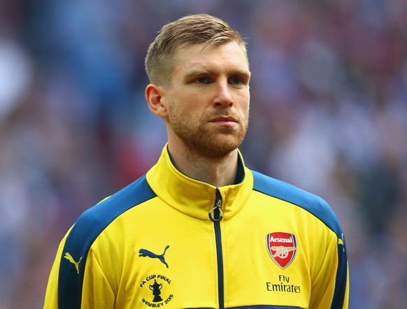 LONDON, ENGLAND - MAY 30:  Per Mertesacker of Arsenal looks on prior to the FA Cup Final between Aston Villa and Arsenal at Wembley Stadium on May 30, 2015 in London, England.  (Photo by Paul Gilham/Getty Images)