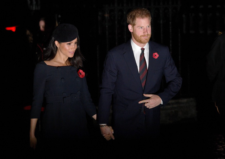 LONDON, ENGLAND - NOVEMBER 11: Prince Harry, Duke of Sussex and Meghan, Duchess of Sussex attend a service marking the centenary of WW1 armistice at Westminster Abbey on November 11, 2018 in London, England. The armistice ending the First World War between the Allies and Germany was signed at Compiègne, France on eleventh hour of the eleventh day of the eleventh month - 11am on the 11th November 1918. This day is commemorated as Remembrance Day with special attention being paid for this year's centenary.  (Photo by Leon Neal/Getty Images)