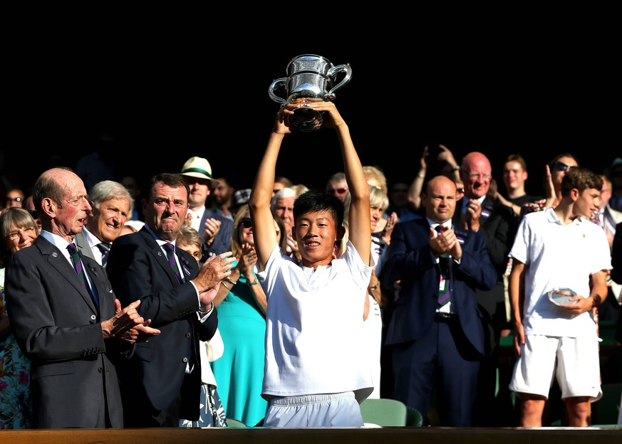 15th July 2018, All England Lawn Tennis and Croquet Club, London, England; The Wimbledon Tennis Championships, Day 13; Chun Hsin Tseng (TWN) lifts the Boy s Single Trophy after defeating Jack Draper (GBR) in the Final PUBLICATIONxINxGERxSUIxAUTxHUNxSWExNORxDENxFINxONLY ActionPlus12048167 JohnxPatrickxFletcher