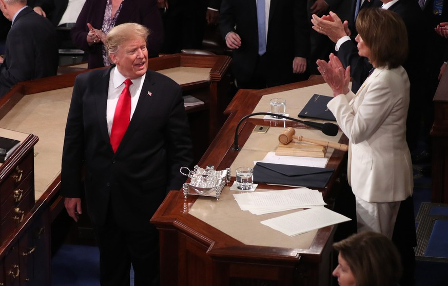 U.S. President Donald Trump says something to Speaker of the House Nancy Pelosi (D-CA) after concluding his second State of the Union address to a joint session of the U.S. Congress in the House Chamber of the U.S. Capitol in Washington, U.S. February 5, 2019. REUTERS/Jonathan Ernst