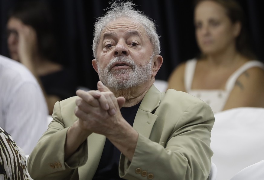 Former Brazilian President Luiz Inacio Lula da Silva gestures to supporters during the launch of his book, in Sao Paulo, Brazil, Friday, March 16, 2018. In his book entitled