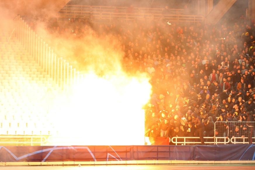 AEK Athens v Ajax Amsterdam UEFA Champions League A petrol bomb goes off in front of Ajax Amsterdam fans ahead of the UEFA Champions League match at Olympic Stadium, Athens PUBLICATIONxNOTxINxUK Copyright: xYannisxHalasx FIL-12606-0004