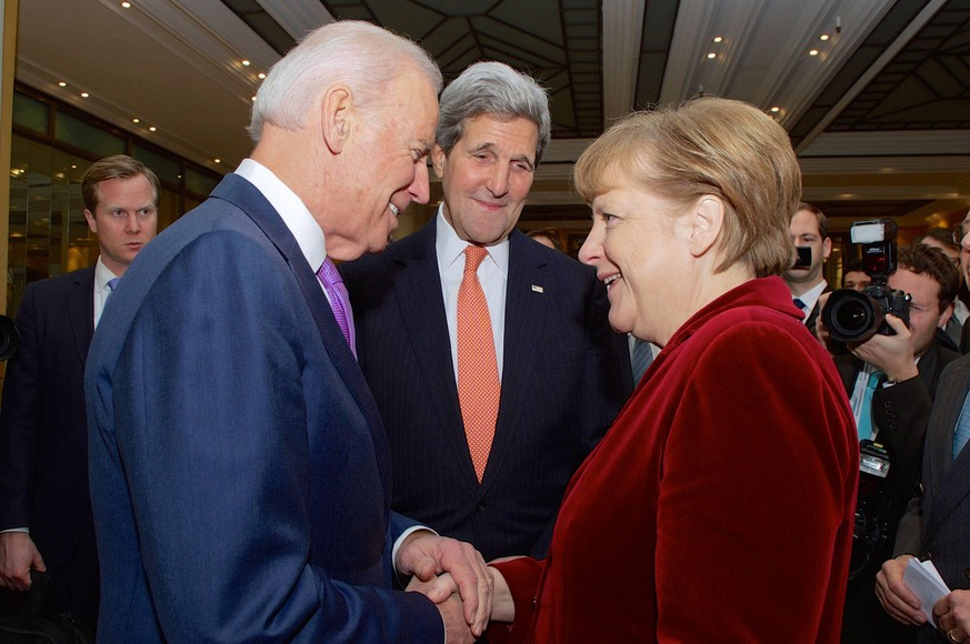 Feb. 7, 2015 - Munich, Germany - U.S. Vice President Joe Biden and Secretary of State John Kerry greet German Chancellor Angela Merkel on the sidelines of the Munich Security Conference February 7, 2015 in Munich, Germany. Munich Germany  - ZUMAp138