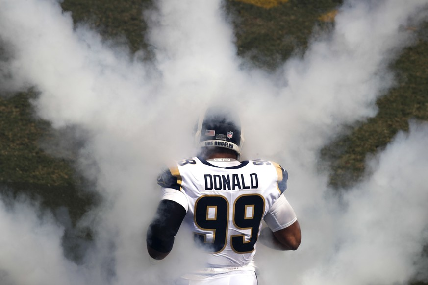 Los Angeles Rams' Aaron Donald runs onto the field before an NFL football game against the Los Angeles Chargers Sunday, Sept. 23, 2018, in Los Angeles. (AP Photo/Jae C. Hong)