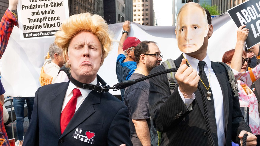 May 23, 2018 - New York, NY, United States - A fake Donald Trump on a leash held by a fake Vladimir Putin at a protest rally against Donald Trump outside the Lotte New York Palace Hotel in New York City..Protesters took to the street to New York City in an anti Donald Trump rally against his foreign policy |