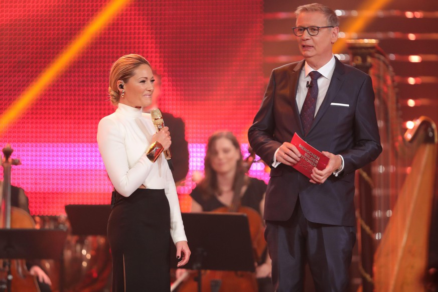 HUERTH, GERMANY - DECEMBER 06: Helene Fischer and Guenther Jauch speak on stage during the tv show