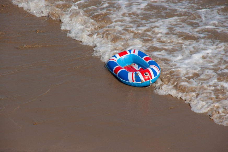 A united kingdom inflatable boat at waters edge
