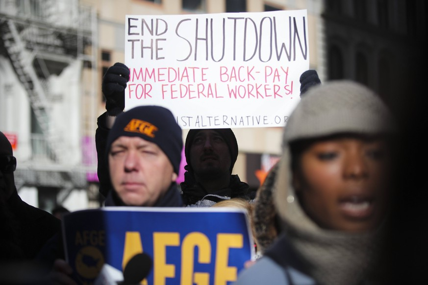 (190122) -- NEW YORK, Jan. 22, 2019 -- People attend a rally to protest against government shutdown outside a federal government building in New York, the United States, Jan. 15, 2019. The ongoing partial government shutdown, already the longest in U.S. history, began on Dec. 22, 2018, as the White House and Democratic Congressional leaders failed to agree on a budget to fund the U.S.-Mexico border wall, a promise made by President Donald Trump during his campaign. About a quarter of federal agencies have been paralyzed due to lack of funding, as the partial government shutdown stretches to its second month. Experts and lawmakers have warned it will inflict far greater damage on the U.S. economy than previously anticipated. ) U.S.-PARTIAL GOVERNMENT SHUTDOWN-SECOND MONTH-IMPACTS WangxYing PUBLICATIONxNOTxINxCHN