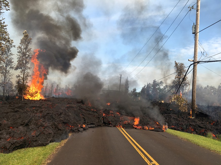 Lava advances along a street near a fissure in Leilani Estates, on Kilauea Volcano's lower East Rift Zone, Hawaii, the U.S., May 5, 2018. U.S. Geological Survey/Handout via REUTERS   THIS IMAGE HAS BEEN SUPPLIED BY A THIRD PARTY. IT IS DISTRIBUTED, EXACTLY AS RECEIVED BY REUTERS, AS A SERVICE TO CLIENTS     TPX IMAGES OF THE DAY