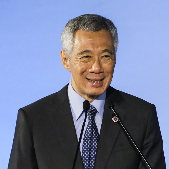 Singapore's Prime Minister Lee Hsien Loong delivers the opening address during the opening ceremony of the 51st ASEAN Foreign Ministers Meeting in Singapore, Thursday, Aug. 2, 2018. (AP Photo/Yong Teck Lim)
