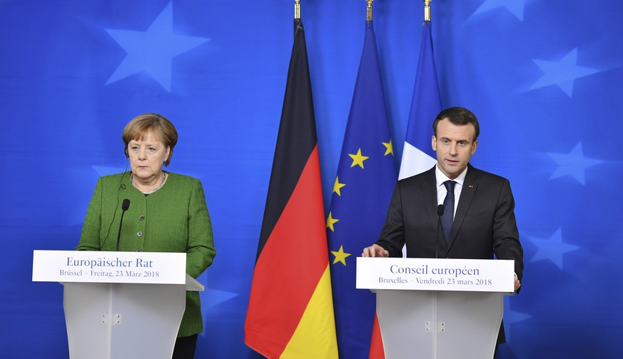 French President Emmanuel Macron, right, and German Chancellor Angela Merkel participate in a media conference at the conclusion of an EU summit in Brussels on Friday, March 23, 2018. (Geert Vanden Wijngaert)