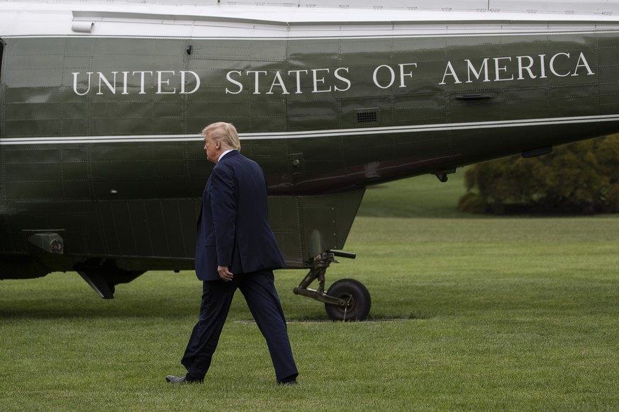 President Donald Trump walks to Marine One as he departs the White House, Friday, July 24, 2020, in Washington. Trump is en route to Trump National Golf Club in Bedminster, N.J., (AP Photo/Alex Brandon)