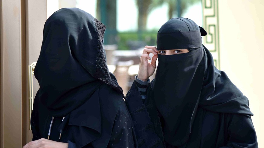 (151212) -- RIYADH, Dec. 12, 2015 -- Women walk out of a polling station after casting their votes for municipal elections in Riyadh, Saudi Arabia, Dec. 12, 2015. More than 1.4 million people are eligible to vote, including 130,637 females who will be allowed to contest and cast ballots in the third municipal poll. It is Saudi Arabia s first elections open to women. )(azp) SAUDI ARAB-RIYADH-MUNICIPAL ELECTION WangxBo PUBLICATIONxNOTxINxCHN