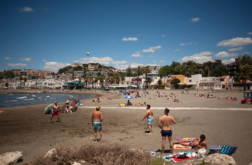 June 13, 2020, Malaga, Spain: People enjoy the weather on a sunny day at Pedregalejo beach amid easing of restrictions caused by COVID-19 outbreak..Most cities in Spain are in phase three where people move and go to other provinces in the same autonomous community. The Spanish government says that the state of emergency period will end on the 21 of June after three months of lockdown, and then they will begin a ''new normality'', following health and safety measures until exists of a vaccine. (Credit Image: