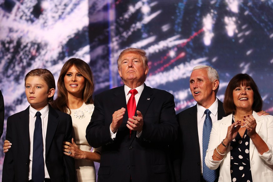 CLEVELAND, OH - JULY 21:  (L-R) Barron Trump, Melania Trump, Republican presidential candidate Donald Trump, Republican vice presidential candidate Mike Pence and Karen Pence acknowledge the crowd at the end of the the Republican National Convention on July 21, 2016 at the Quicken Loans Arena in Cleveland, Ohio. Republican presidential candidate Donald Trump received the number of votes needed to secure the party's nomination. An estimated 50,000 people are expected in Cleveland, including hundreds of protesters and members of the media. The four-day Republican National Convention kicked off on July 18.  (Photo by John Moore/Getty Images)