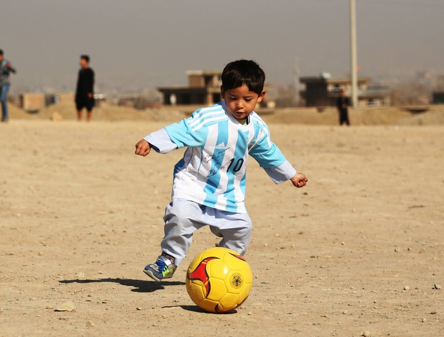 (160226) -- KABUL, Feb. 26, 2015 -- Afghan boy Murtaza Ahmadi plays football wearing a new jersey signed by Argentina soccer star Lionel Messi of Spanish Barcelona FC in Kabul, capital of Afghanistan, Feb. 26, 2016. Murtaza Ahmadi who became a social media hit after wearing a plastic bag bearing Lionel Messi s number 10 finally received the real thing which was sent from the Argentine footballer himself. Five-year-old Murtaza Ahmadi, tagged as Messi s biggest fan , has been sent a signed Argentina shirt and football from the Barcelona forward. ) (SP)AFGHANISTAN-KABUL-AFGHAN BOY RECEIVED MESSI S JERSEY RahmatxAlizadah PUBLICATIONxNOTxINxCHN