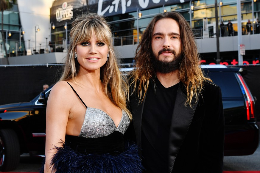 LOS ANGELES, CALIFORNIA - NOVEMBER 24: (L-R) Heidi Klum and Tom Kaulitz attend the 2019 American Music Awards at Microsoft Theater on November 24, 2019 in Los Angeles, California. (Photo by Emma McIntyre/Getty Images for dcp)