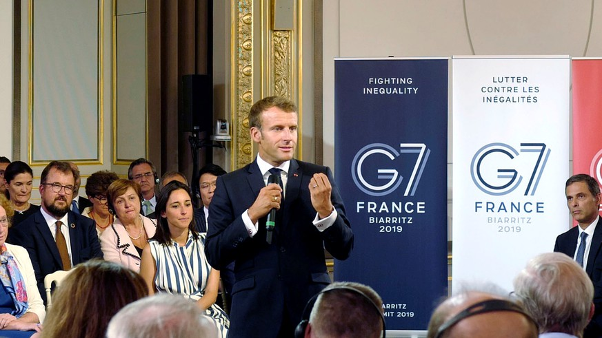 French President Emmanuel Macron delivers a speech on environment and social equality to business leaders on the eve of the G7 summit in Paris, France August 23, 2019. Michel Spingler/Pool via REUTERS