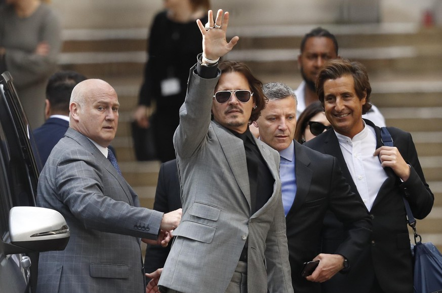 American actor Johnny Depp, waves as he leaves after the end of the trial at the High Court in London, Tuesday, July 28, 2020. Hollywood actor Johnny Depp is suing News Group Newspapers over a story about his former wife Amber Heard, published in The Sun in 2018 which branded him a 'wife beater', a claim he denies. (AP Photo/Alastair Grant)