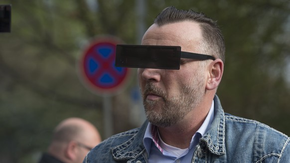 DRESDEN, GERMANY - APRIL 19: Lutz Bachmann, wearing black glasses, founder of the Pegida movement, arrives for the first day of his trial to face charges of hate speech on April 19, 2016 in Dresden, Germany. Bachmann is accused of rabble-rousing.The charges stem from Bachmann's Facebook descriptions of arriving refugees in Germany as