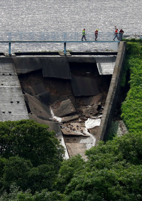 A damaged dam is seen after a nearby reservoir was affected by flooding, in Whaley Bridge, Britain August 1, 2019. REUTERS/Phil Noble