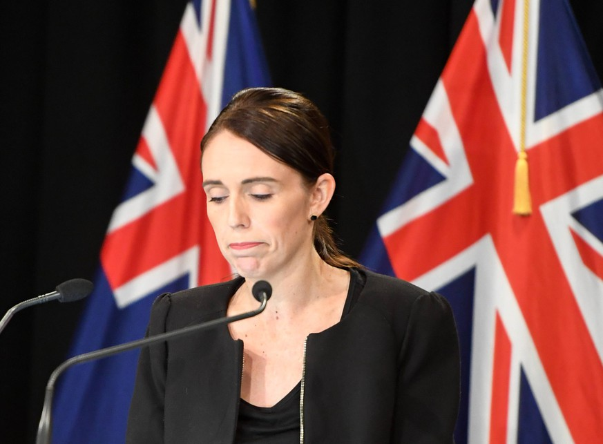 (190316) -- WELLINGTON, March 16, 2019 (Xinhua) -- New Zealand Prime Minister Jacinda Ardern reacts during a briefing in Wellington, capital of New Zealand, on March 16, 2019. Jacinda Ardern reiterated to the public on Saturday morning that the country s gun law will be changed. Gunmen opened fire in two separate mosques in Christchurch on Friday, killing 49 people and wounding 48 others. (Xinhua/Guo Lei) NEW ZEALAND-WELLINGTON-PM-CHRISTCHURCH-ATTACKS-BRIEFING PUBLICATIONxNOTxINxCHN