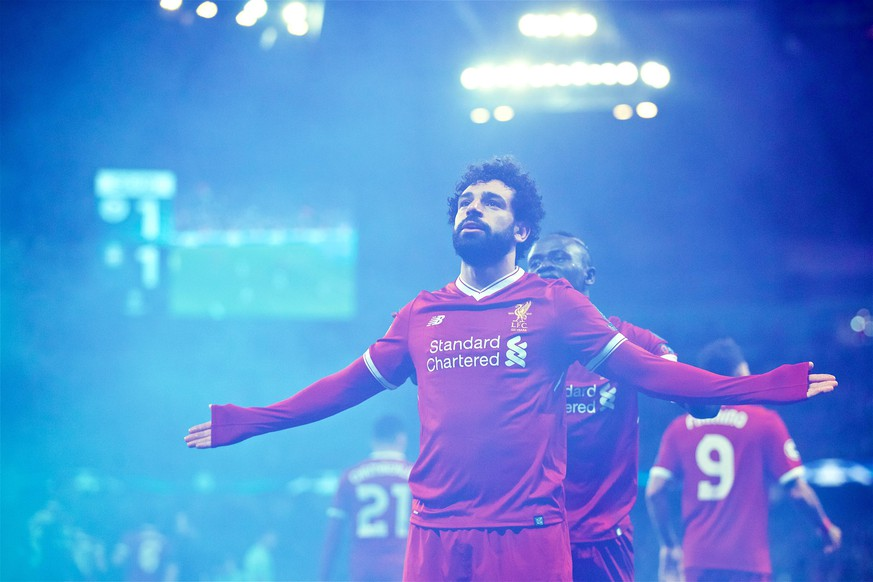 (180411) -- MANCHESTER, April 11, 2018 () -- Liverpool s Mohamed Salah celebrates after scoring during the UEFA Champions League quarterfinal second leg soccer match between Manchester City and Liverpool in Manchester, Britain, on April 10, 2018. Liverpool won 5-1 on aggregate and advanced to the semifinal. () FOR EDITORIAL USE ONLY. NOT FOR SALE FOR MARKETING OR ADVERTISING CAMPAIGNS. NO USE WITH UNAUTHORIZED AUDIO, VIDEO, DATA, FIXTURE LISTS, CLUB/LEAGUE LOGOS OR LIVE SERVICES. ONLINE IN-MATCH USE LIMITED TO 45 IMAGES, NO VIDEO EMULATION. NO USE IN BETTING, GAMES OR SINGLE CLUB/LEAGUE/PLAYER PUBLICATIONS.) (SP)BRITAIN-MANCHESTER-SOCCER-UEFA CHAMPIONS LEAGUE-MANCHESTER CITY VS LIVERPOOL Xinhua PUBLICATIONxNOTxINxCHN