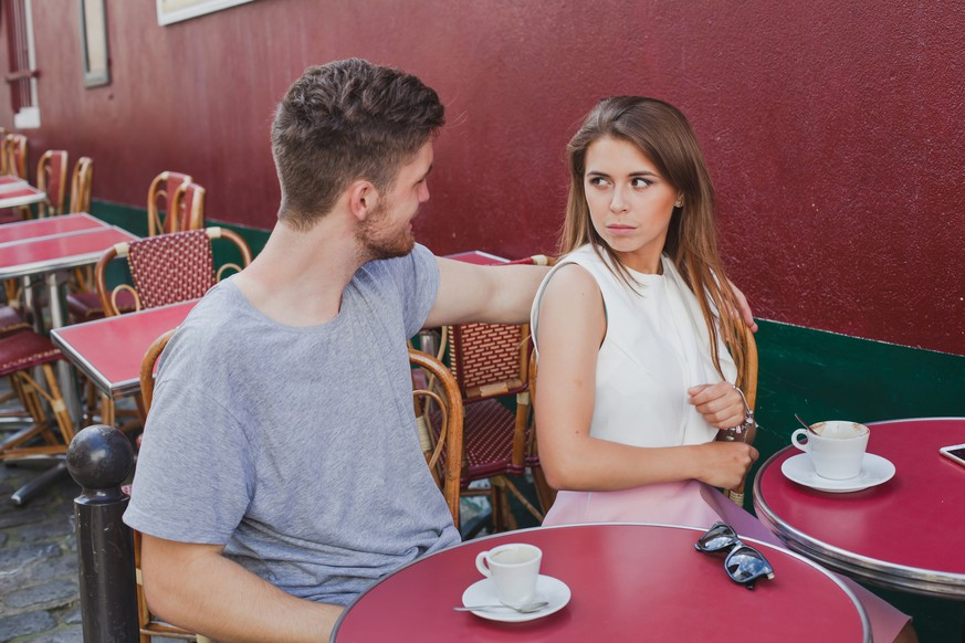Woman rejecting hugs of man, unhappy girl with annoying boyfriend