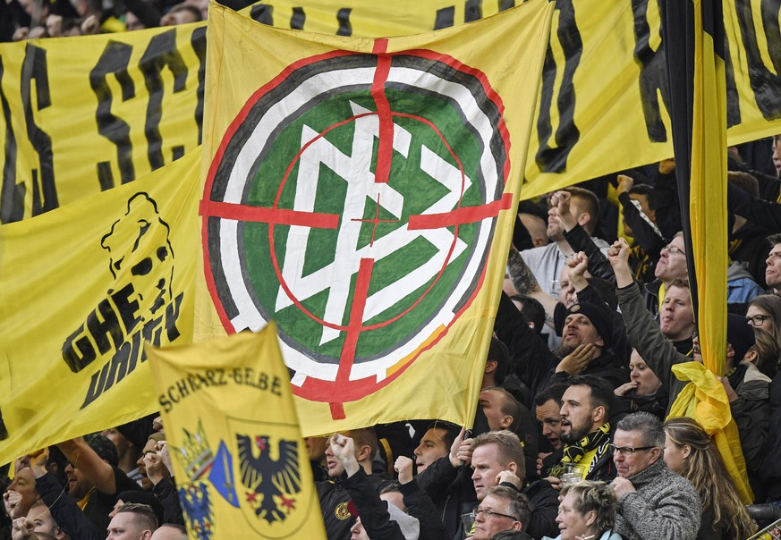 Dortmund's Ultras show a logo of the German Football Federation, DFB, in crosshairs during the German Bundesliga soccer match between Borussia Dortmund and SC Freiburg in Dortmund, Germany, Saturday, Feb. 29, 2020. (AP Photo/Martin Meissner)