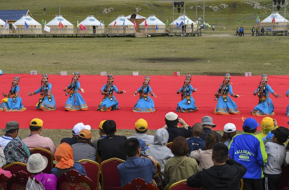 (180818) -- HEJING, Aug. 18, 2018 -- Dancers perform during a Nadam fair, which kicks off on Aug. 18, 2018, in Hejing County, northwest China s Xinjiang Uygur Autonomous Region. Nadam, meaning entertainment or recreation in Mongolian, is a folk festival of the Mongolian ethnic group. ) (ly) CHINA-XINJIANG-HEJING-NADAM FAIR-OPEN (CN) HuxHuhu PUBLICATIONxNOTxINxCHN