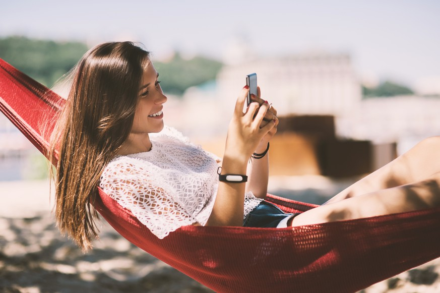 Smiling girl taking selfies beach lying hammock, Smart Phone, Summer holiday vacation scene