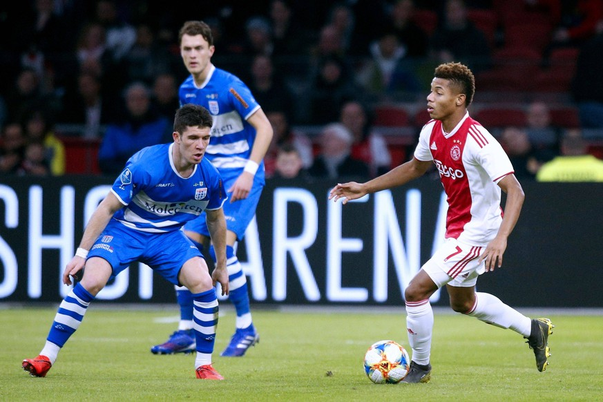 AMSTERDAM, Ajax - PEC Zwolle, 13-03-2019 football, Dutch Eredivisie Season 2018 - 2019, Stadium de Arena, Ajax player David Neres (R) and PEC Zwolle player Pelle Clement (L) during the game Ajax - PEC . Ajax - PEC PUBLICATIONxNOTxINxNED x2954787x