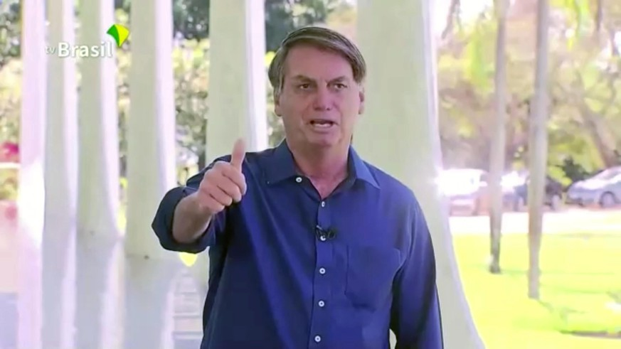 Brazil's President Jair Bolsonaro gestures as he speaks to the media on his positive coronavirus diagnosis in Brasilia, Brazil July 7, 2020 in this still image taken from video. Brazilian Government TV via Reuters TV  THIS IMAGE HAS BEEN SUPPLIED BY A THIRD PARTY. NO RESALES. NO ARCHIVES.