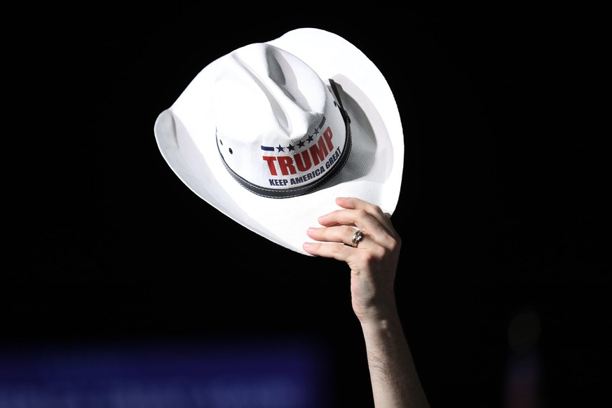 OPA LOCKA, FLORIDA - NOVEMBER 01: A cowboy hat is held up as people wait for the arrival of U.S. President Donald Trump for his campaign event at Miami-Opa Locka Executive Airport on November 1, 2020 in Opa Locka, Florida. President Trump continues to campaign against Democratic presidential nominee Joe Biden leading up to the November 3rd Election Day. (Photo by Joe Raedle/Getty Images)