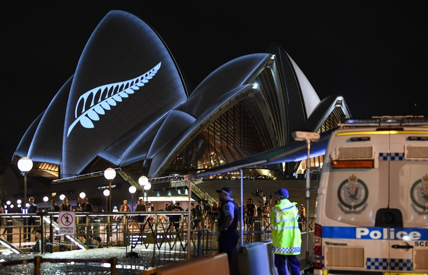 SYDNEY, AUSTRALIA - MARCH 16: A police check point outside the opera House as a silver fern is projected onto the sails in commemoration of the victims of the Christchurch massacre on March 16, 2019 in Sydney, Australia. 49 people are confirmed dead, with 36 injured still in hospital following the shooting attacks on two mosques in Christchurch on Friday, 15 March. 41 of the victims were killed at Al Noor mosque on Deans Avenue and seven died at Linwood mosque. Another victim died later in Christchurch hospital. A 28-year-old Australian-born man, Brenton Tarrant, appeared in Christchurch District Court on Saturday charged with murder. The attack is the worst mass shooting in New Zealand's history. (Photo by James D. Morgan/Getty Images)