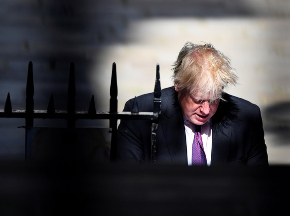 FILE PHOTO: Britain's Foreign Secretary Boris Johnson walks to Downing Street in London, June 26, 2018. REUTERS/Toby Melville/File Photo