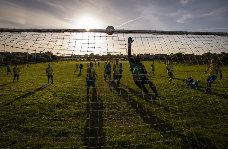 PORTLAND, ENGLAND - APRIL 11: A general view of the action during an amateur non league football match at sunset on April 11, 2017 in Portland, England. (Photo by Justin Setterfield/Getty Images)