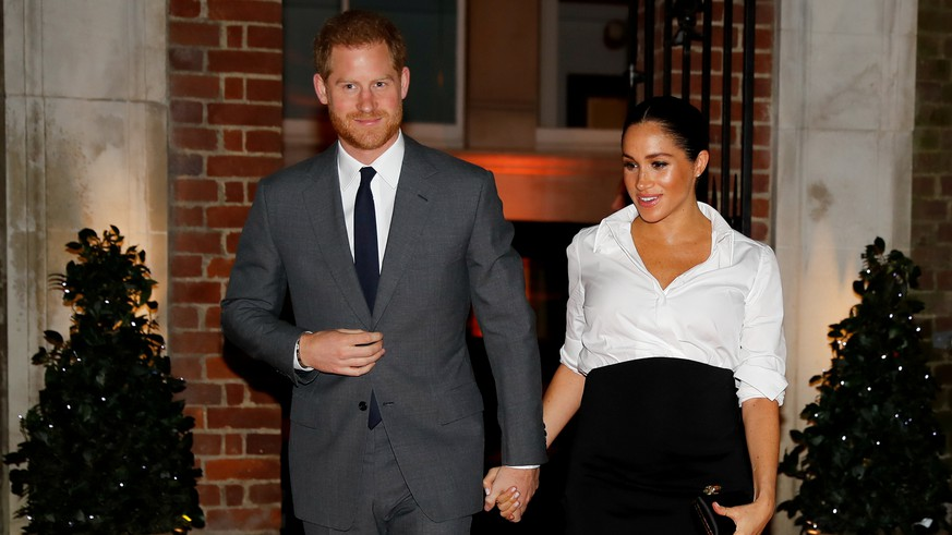 FILE PHOTO: Britain's Prince Harry and Meghan, Duchess of Sussex, arrive to attend the Endeavour Fund Awards in the Drapers' Hall in London, Britain February 7, 2019. Tolga Akmen/Pool via REUTERS/File Photo