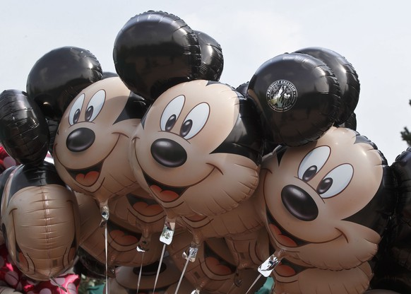 FILE - This May 12, 2015 file photo shows Mickey Mouse balloons at Disneyland Paris, in Chessy, France, east of Paris. Disney is allaying concerns about cord-cutting after reporting better-than-expected revenue in the cable-network division that houses ESPN. Disney said Thursday, Nov. 5, 2015, that revenue at its leading business, cable networks, rose 12 percent to $4.25 billion in the fiscal fourth quarter, beating the $4.22 billion expected by analysts polled by FactSet.  (AP Photo/Michel Euler, File) |