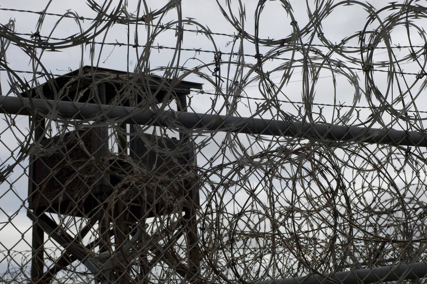 Oct 02, 2007 - Guantanamo Bay, Cuba - A fence, guard tower and razor wire in Camp X-ray, which is now closed and was the initial facility used to hold detainees in Guantanmo Bay. The U.S. Government is currently holding approximately 340 enemy combatants in Guantanamo Bay, Cuba. They were captured during the Global War on Terrorism after the attacks on the United States on September 11, 2001. Guantanamo Bay Cuba PUBLICATIONxINxGERxSUIxAUTxONLY - ZUMAp79_