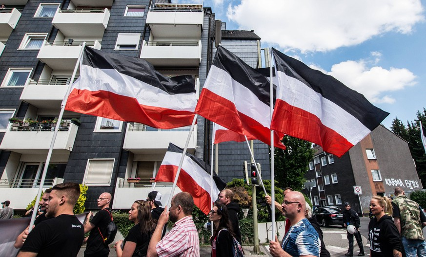 May 25, 2019 - Dortmund, Nordrhein Westfalen, Germany - The 1933-1935 German flags waved by neonazis in Dortmund, Germany. Prior to the European Elections, the neonazi party Die Rechte (The Right) organized a rally in the German city of Dortmund to promote their candidate, the incarcerated Holocaust denier Ursula Haverbeck. The demonstration and march were organized by prominent local political figure and neonazi activist Michael Brueck (Michael Bro¼ck) who enlisted the help of not only German neonazis, but also assistance from Russian, Bulgarian, Hungarian, and Dutch groups with the final tally ranging from 180-250. The police reported various incidents, including forbidding the use of a banner with former President of Iran Ahmadenijad, who the group states is an ally. Later, the parade was stopped due to the use of â€oehere we PUBLICATIONxINxGERxSUIxAUTxONLY - ZUMAb160 20190525_zbp_b160_091 Copyright: xSachellexBabbarx