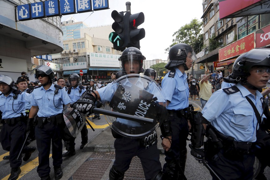 Hong Kong police push back protesters in Hong Kong Saturday, July 13, 2019. Several thousand people marched in Hong Kong on Saturday against traders from mainland China in what is fast becoming a summer of unrest in the semi-autonomous Chinese territory. (AP Photo/Kin Cheung)