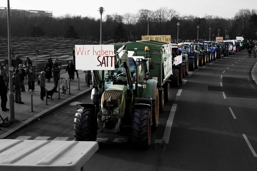 BERLIN, GERMANY - JANUARY 19: Farmers' tractors participate in a protest march over agricultural policy on January 19, 2019 in Berlin, Germany. Thousands of people participated in the march to protest against the current system of disbursement of EU farm subsidies in Germany. Activists complain that large-scale farms receive too much and that the system needs to better fund farmers pursuing environment and climate-friendly farming methods. The protest is coinciding with the Green Week agricultural trade fair currently taking place in Berlin. (Photo by Carsten Koall/Getty Images)